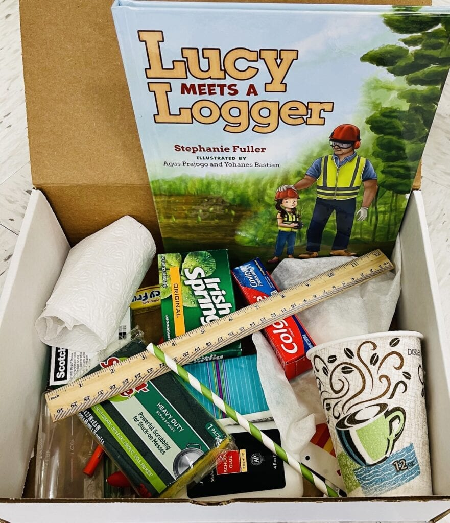 Each classroom received an educational kit containing a copy of Lucy Meets a Logger and many of the products mentioned in the book.