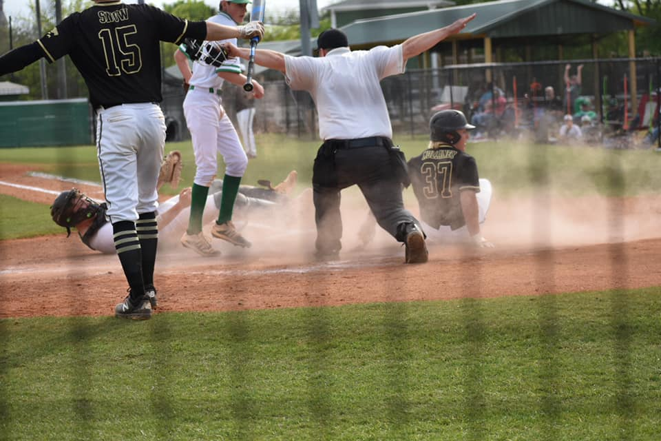 Hayden's Mason Mullaney is safe at home for the Wildcats' final run in their 7-1 game one victory over Leeds. The Wildcats won game two 10-2 to advance to round two. -Lena Simmons