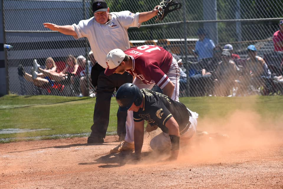 Hayden's Carson Simmons is called safe at home. -Lena Simmons
