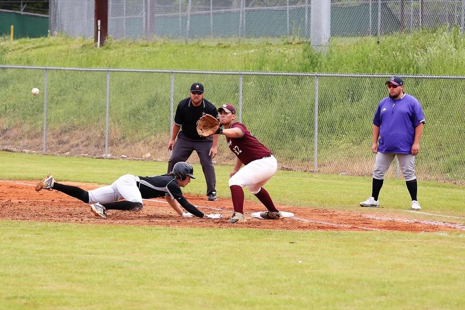 Southeastern's first Kevin Juhola holds a Decatur Christian runner on first. -Jeff Sargent