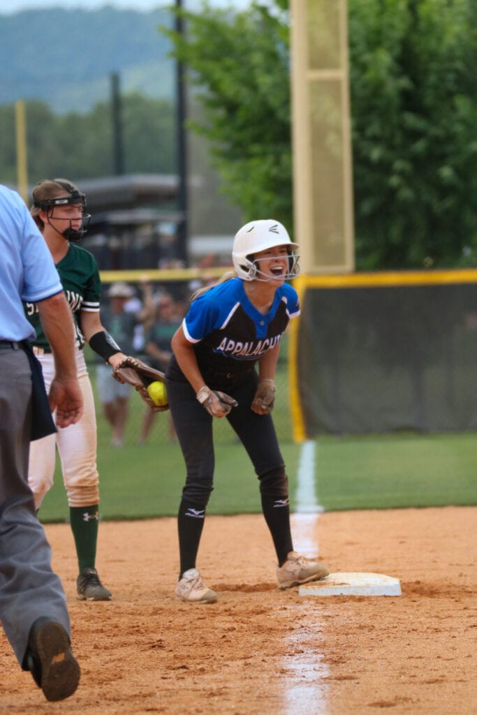 Taylor Woodard celebrates after a triple. She hit one against Pleasant Home, Holy Spirit Catholic, Brantley, and Skyline. -Mandy Moore Photography