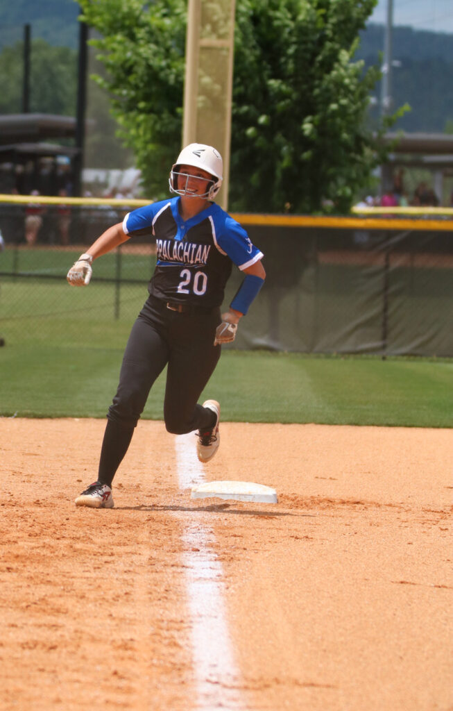 Zoe Payne rounds third after a home run against Pleasant Home. -Mandy Moore Photography