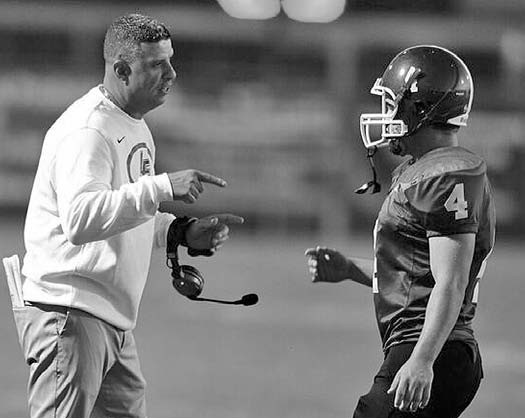 Locust Fork head coach Chris Musso gets his point across to Hunter Neely. -www.southernexposurephotos.com