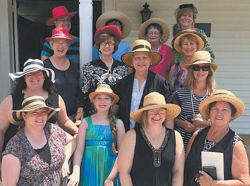 Church ladies wear hats in support of Annette Drake's battle with cancer.