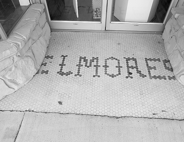 Tiles spelling Elmore's retain some of the building's historic past. Clemons purchased the buildings with intentions of preserving them as well as using them for retail space.