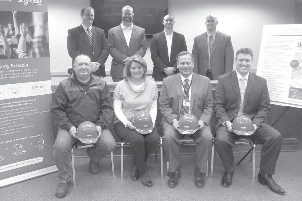 Kickoff meeting. Front row from left: Ken Parker, Blount County schools operations director; Cindy Parker, Blount County Schools chief financial officer; Rodney Green, Blount County Schools Superintendent; Todd Smith, Schneider Electric account executive. Back row from by Ron Gholson left: Caleb Ringelberg, Schneider project manager; John Rehus, Schneider performance assurance manager; Payne Walters, Schneider project manager; Brett Crow, Schneider project development engineer.
