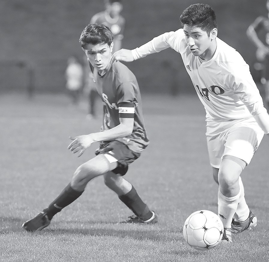 Oneonta's Eric Vargas works around Susan Moore's Jason Mejia. -BCaptivated Photography