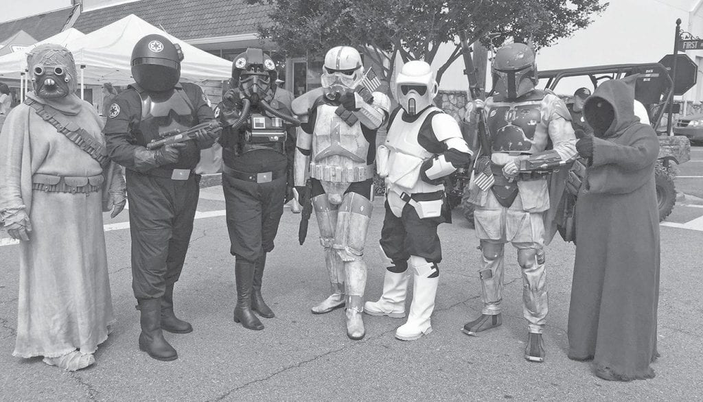 The Alabama Garrison of the 501st Legion provide roaming Star Wars characters eager for photo ops. -501st Legion
