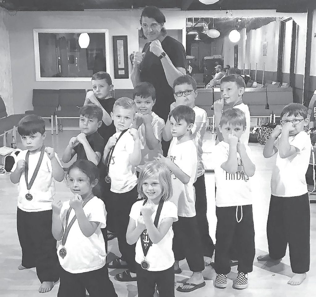 Little Ninjas with Sensei Cole Rheal are: Gabe Bresnahan, Blake Russell, Beau Russell, Wyatt West, Titus Wright, Eli Wright, Serenity Holland, AJ Brewer, Finn Doty, Ben Washburn, Leyla Martinez, and River Murphree.