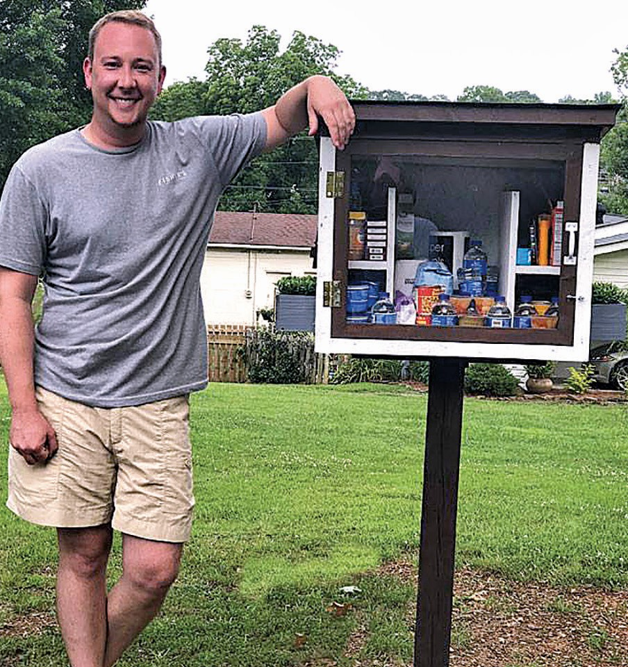 Richard Phillips encourages citizens to spread the word about the Little Free Pantry on Fourth Avenue. The inset displays items available for those in need.