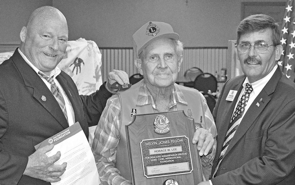 From left: Hayden Lions Club president Tim Sosebee, Lion Horace Lee, and past council chairman for the North Alabama District Ron Seybold