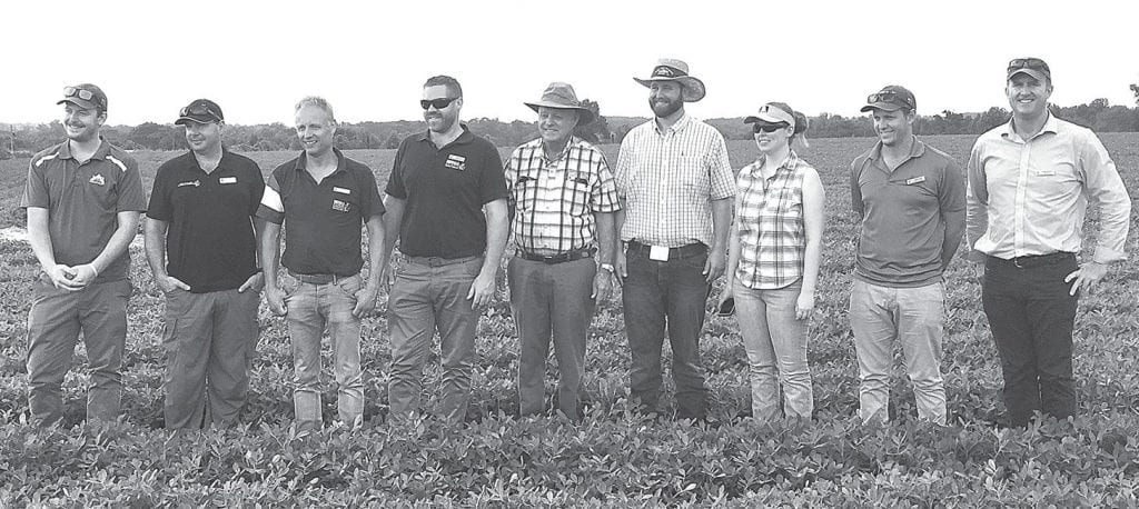 Photo line: Nuffield Australia scholars learned much about peanut production while touring Miller Farms. From left: Andre Henry, Simon Cook, Robert Nijkamp, Steve Grist, Jimmy Miller, Lance Miller, Stephanie Miller, Dylan Hirsch, and Steuart McDonald. Henry, Grist, Hirsch, and McDonald are from Australia, Cook is from New Zealand, and Nijkamp is from the Netherlands.