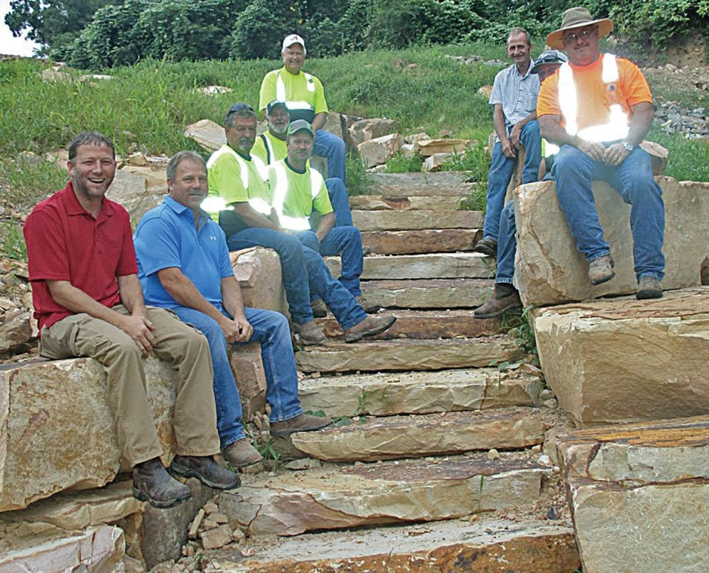 District 3 wonder workers, from bottom left: Rex Harper, Commissioner Dean Calvert, Ray Smith, Dean Shelton, David Kemp, Jerry Epps, Jeff Harper, Ed Bell (partially hidden), and David Collier. Inset: A scenic view of the stairway allowing access to the river below.