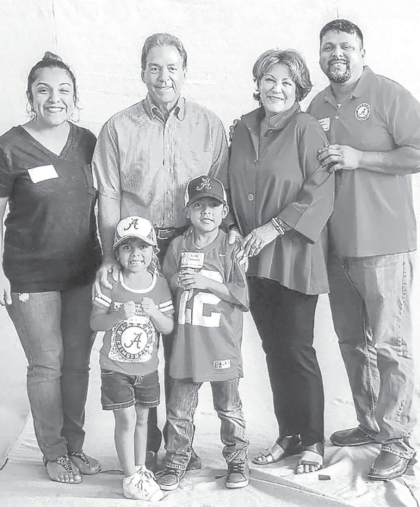 Pictured with Coach and Mrs. Saban, are (from left) Aleyda Villegas, Blount County Children's Center Family Services Specialist, Evaly and Edrick Gonzalez (Aleyda's children), and Juan Gonzalez (her husband). -Blount County Children's Center