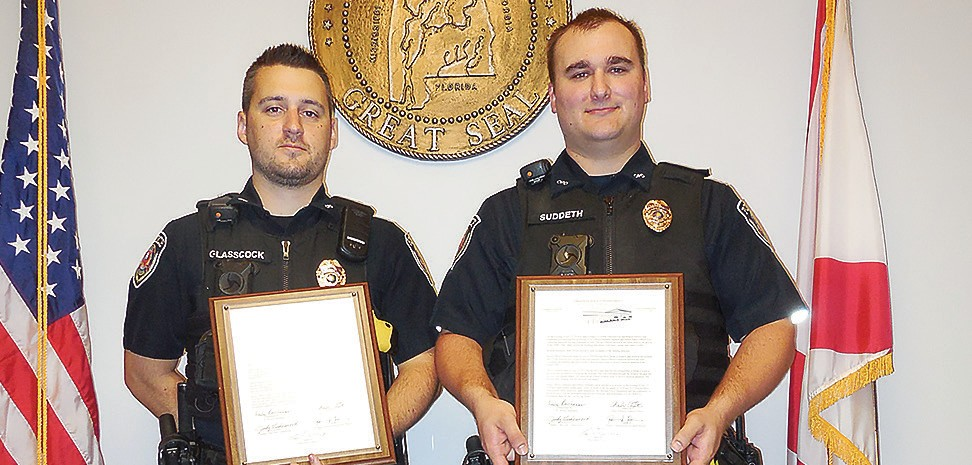 Cory Glasscock and Matthew Suddeth display citations from the Oneonta City Council for their heroic efforts to save two women from an apartment fire.