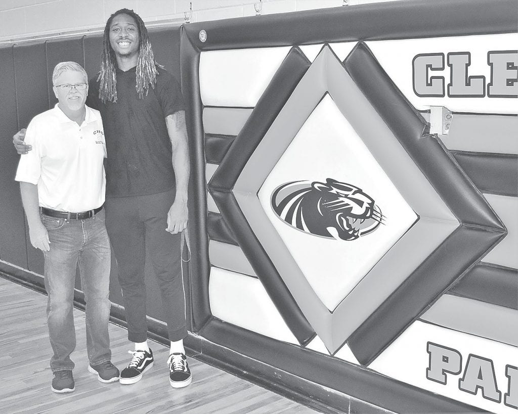 Conny Lowery congratulates former Cleveland High School basketball player Emanuel Terry.
