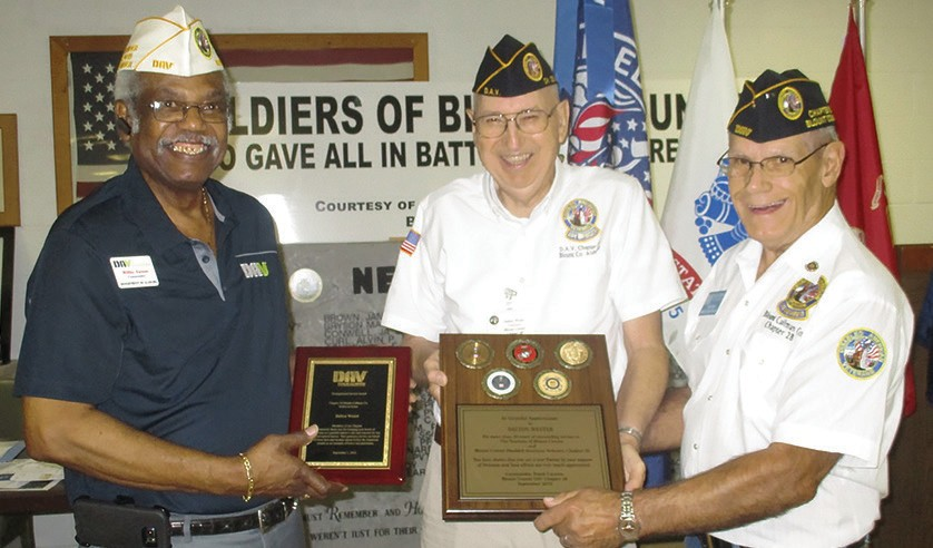 Dalton Wester (center), mainstay for decades to Blount County veterans, receives two plaques honoring his service to the Disabled American Veterans (DAV) organization. From left, Willy Tatum, state commander of the DAV, Wester, and Frank Cannon, commander of Blount County DAV Chapter 28.