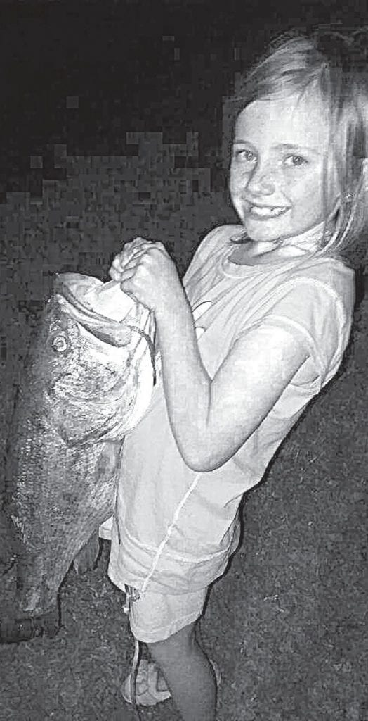 This is a keeper! Riley Green with her big bass.
