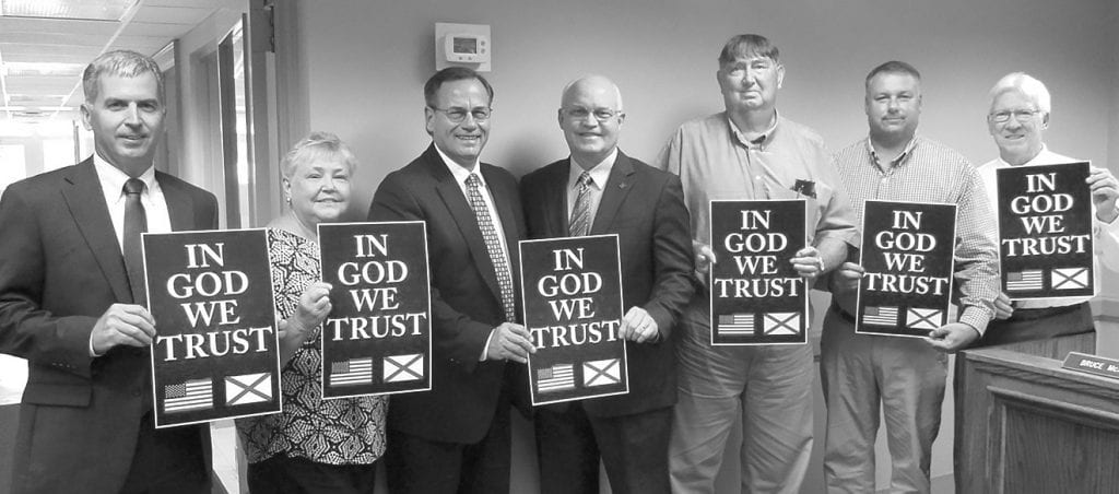 "School board memorializes approval of ""In God We Trust"" resolution, permitting display of national motto in Blount County Schools classrooms. From left: president Chris Latta, Jackie Sivley, Superintendent Rodney Green, District 34 Rep. David Standridge, Bruce McAfee, William Ferry, Ken Benton."