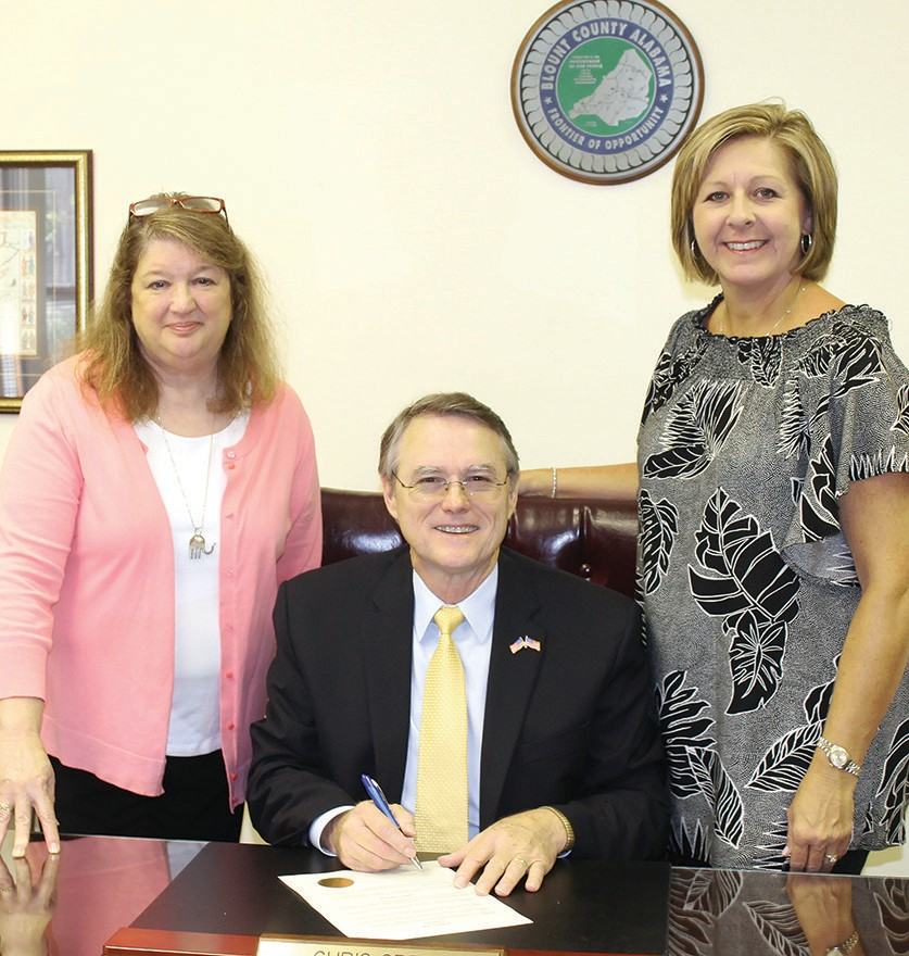 From left: Jane Longshore, Blount County Probate Judge Chris Green (signing the official proclamation declaring September 17-23 as Constitution Week in Blount County), and Marla Smith.