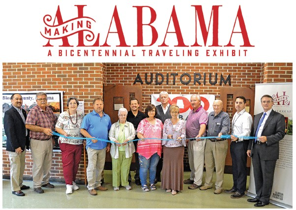 Blount County Memorial Museum (BCMM) curator Amy Rhudy was flanked right and left last Thursday by local officials and members of the Blount County Historical Society (BCHS) as she cut the ribbon officially opening the Making Alabama: A Bicentennial Traveling Exhibit.