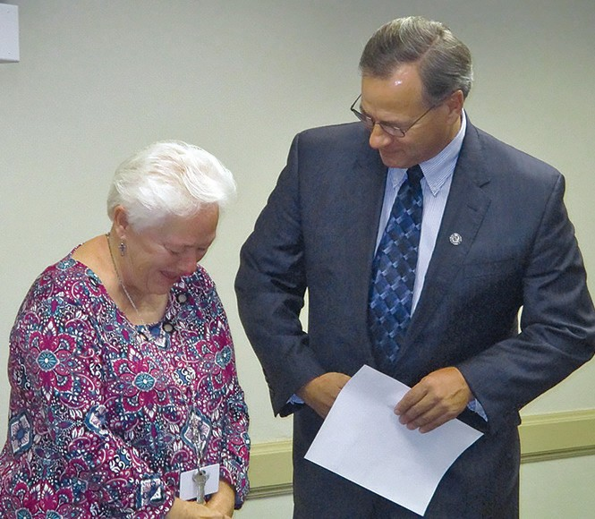 """Janet Lake, left, federal programs employee in the Blount County Schools central office, tears up briefly while telling Superintendent Rodney Green that she enjoyed every minute of the 27 years she has spent working with her friends and colleagues at the county school system. From their comments, the feeling was mutual. Former superintendent Jim Carr, who made an appearance to congratulate her on her retirement, referred to her as 'a special lady of unmeasured kindness and loyalty."""""""