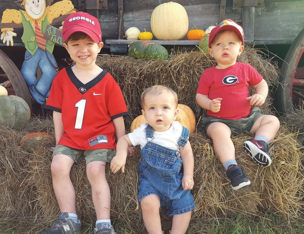 Just some cutie pies enjoying the pumpkin patch. From left, David Conn, Michael Helton, and James Conn take a break from all the fun.