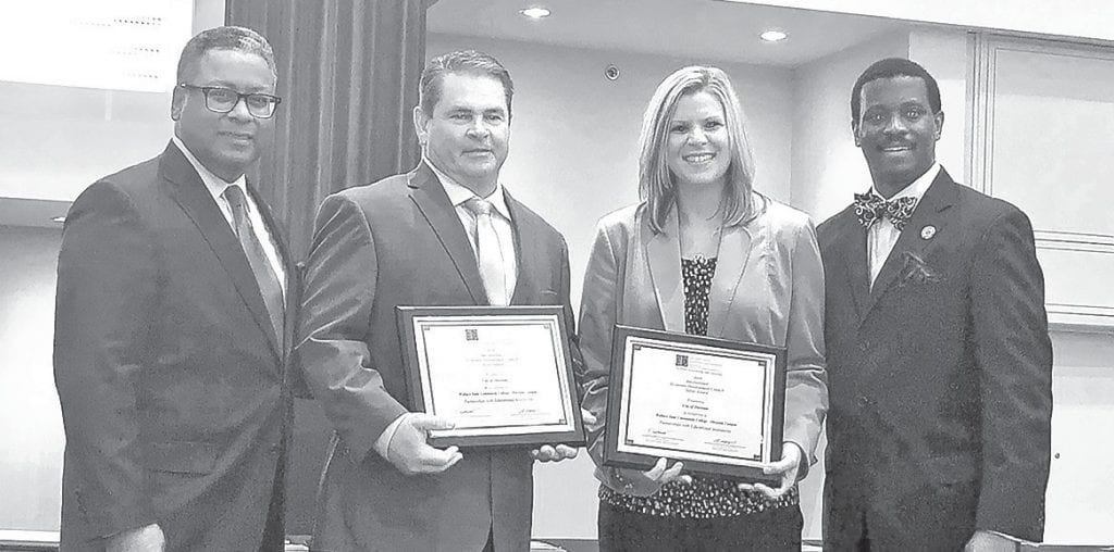 IEDC Board Chairman Craig Richard (left), Oneonta city manager Ed Lowe, Oneonta assistant community developer Allie Allcorn, and IEDC Awards Advisory Committee Chairman Quentin Messer Jr. display the award certificates. -Allie Allcorn