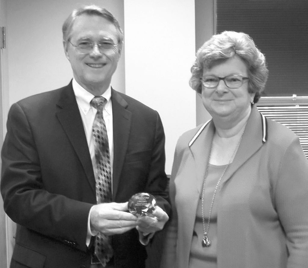 On the occasion of its 20th anniversary, Mitchie Neel, representing the Blount County Education Foundation (BCEF), presents Commission Chairman Chris Green a diamond contributor's award. The Blount County Commission is one of only 31 donors who have contributed to the foundation every year since its founding, she said. The county has contributed $5,000 each year for a total of $100,000 during the period. Meanwhile, BCEF has presented Blount County Schools with nearly $4 million in classroom awards.