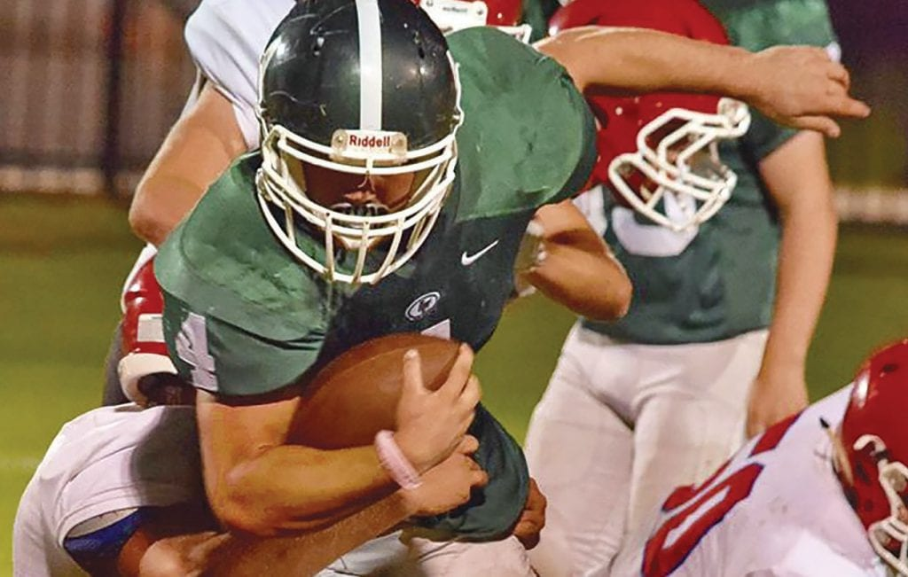 Locust Fork's Hunter Neely adds to his 112 yard rushing total Friday during the Hornet's 38-32 homecoming victory over Vinemont. High school football coverage begins on page A4. -Hannah Payne | Sydney Smith