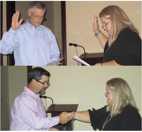 District Judge Sherry Burns administers the oath of office to Patrick Adams (top) and Steve Anderton, both re-elected to four-year terms on the Oneonta City Schools Board of Education.
