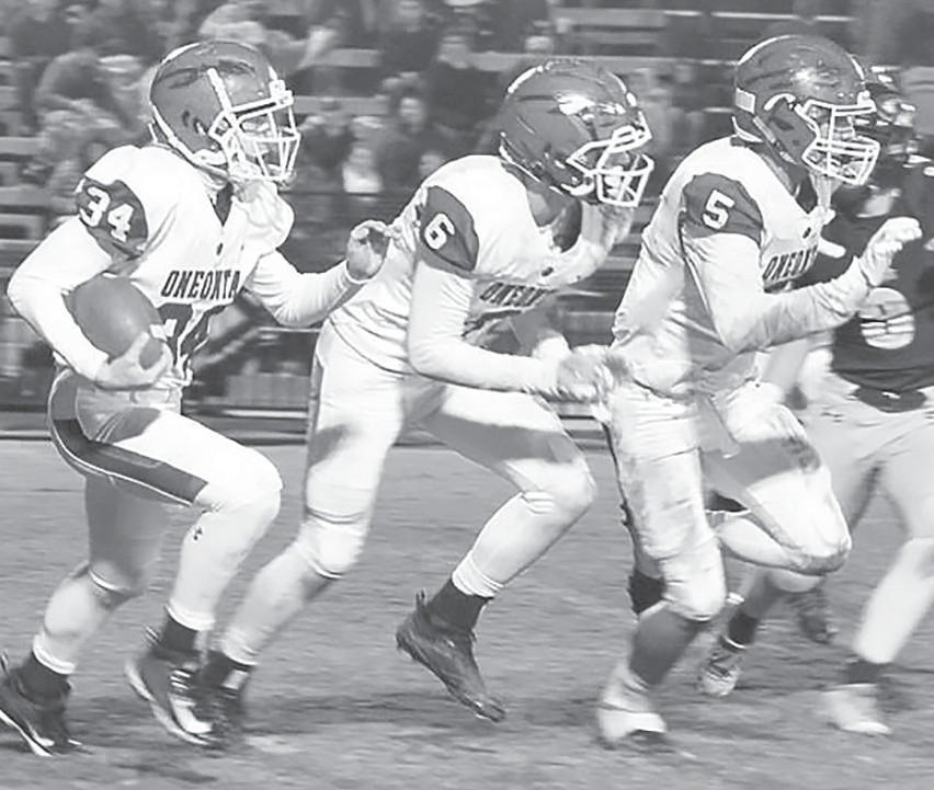 Oneonta's Colin Moon (34) follows Daniel McCary (6) and Jaden Kent (5) for a 40-yard kickoff return against J.B. Pennington -Jimmy Smallwood