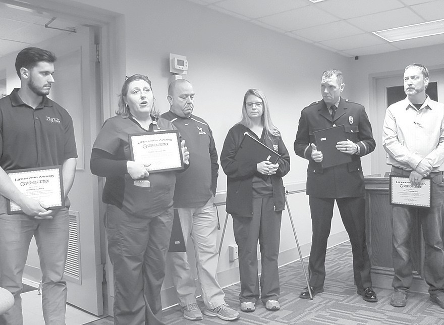 Participants in dramatic life-saving rescue, from left: Joseph Kelleher, private athletic trainer; Teresa Latham, Locust Fork school nurse; Larry Boatright, coach at Locust Fork; Sonya Boatright, privately-employed nurse, also Blount County Schools substitute nurse; Kevin Wilson, firefighter with Mountain Brook Fire Department; Adam Youngblood, coach at Locust Fork. All received Heartsaver/Healer awards recognizing their successful life-saving team effort.
