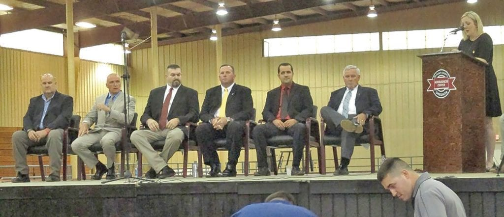May 2, 2018: Candidates for Blount County Sheriff meet at the Agri-Business Center for a public forum in preparation for the primary election June 5. From left: Ron Chastain, Kevin Price, Charlie Turner, Mark Moon, Chase Ramsey, and James Chapman. District Attorney Pamela Casey, standing at right, moderated the event.