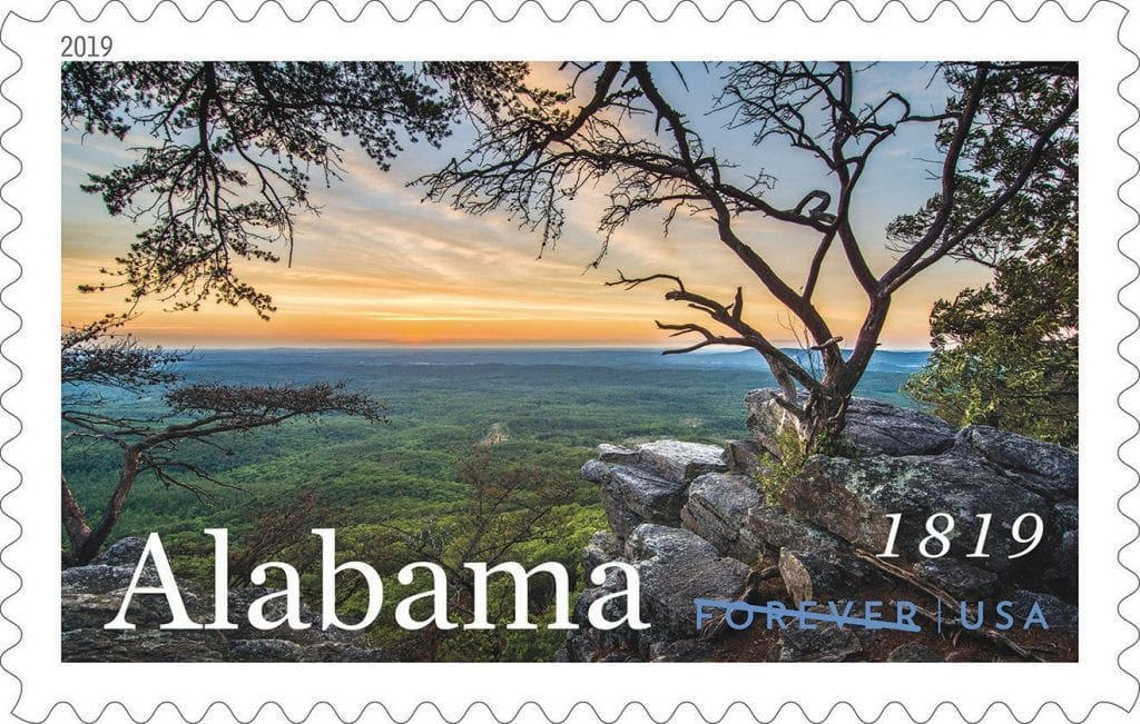 The new USPS Forever stamp celebrating Alabama's bicentennial features a photo taken by local photographer Joe Miller at sunset along Pulpit Rock Trail at Cheaha State Park. (See flickr.com/ photos/ outsideshot for a selection of his other photographs.) The image is one of several new stamp designs to be issued in 2019. The first-day-of-issue ceremony for the Alabama stamp will take place on Saturday, Feb. 23, at Constitution Hall Park in Huntsville, time TBD.