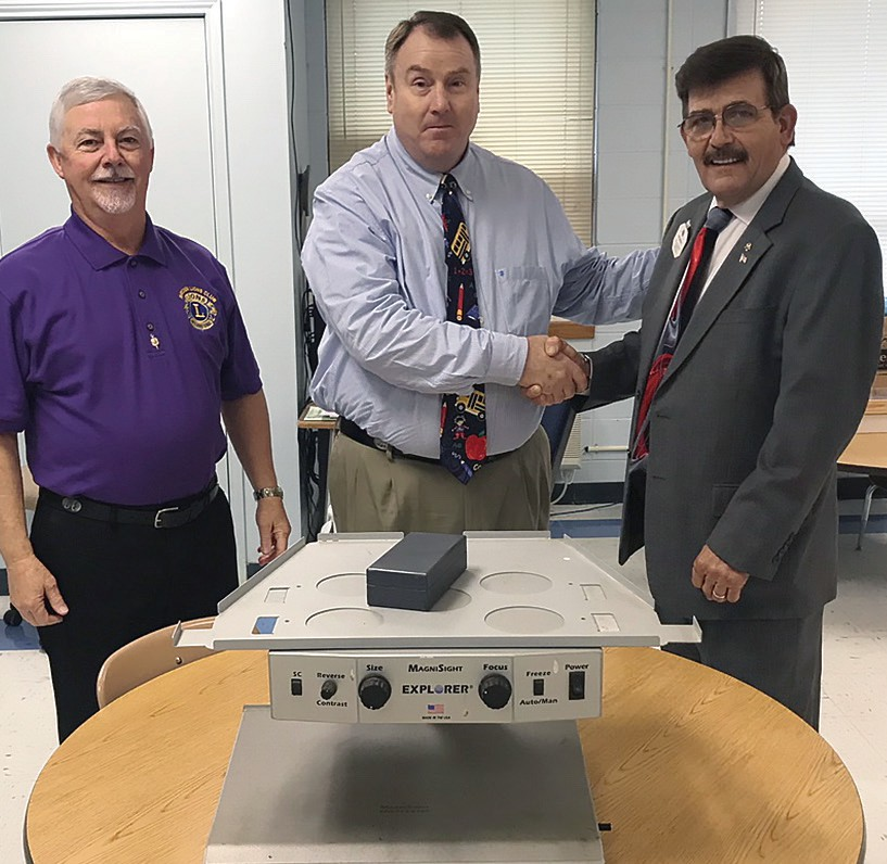From left, Doug Reid (Hayden Lions Club president), Steve Love (Blount County Multi-Needs Center principal), and Ron Seybold (Lions Club organizer).