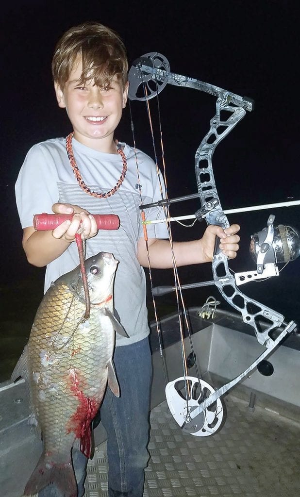 Gabe Henry holds one world and three state records in bow fishing. -David Henry