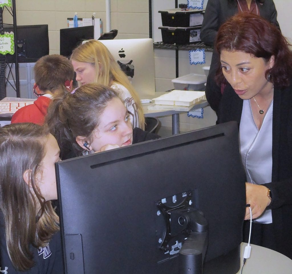 Arzu Atasoy (right), director of Education Academy Foundation in Turkey, observes students in Susan Moore's STEAM lab.