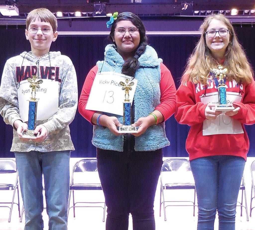 Winners of the 2019 Blount County Spelling Bee are (from left): Ryan Ewing, Locust Fork seventh-grader (first place); Vicky Piceno, Susan Moore sixth-grader (second place); and Lauren Price, Oneonta sixth-grader (third place). -Jim Kilgore