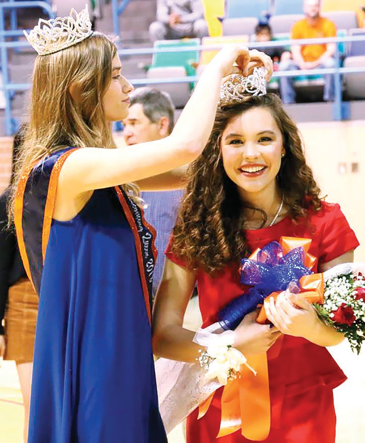 Emily Dia (right) is crowned Wallace State 2019 Homecoming Queen by 2018 Homecoming Queen Challie Johnson. -Wallace State Community College
