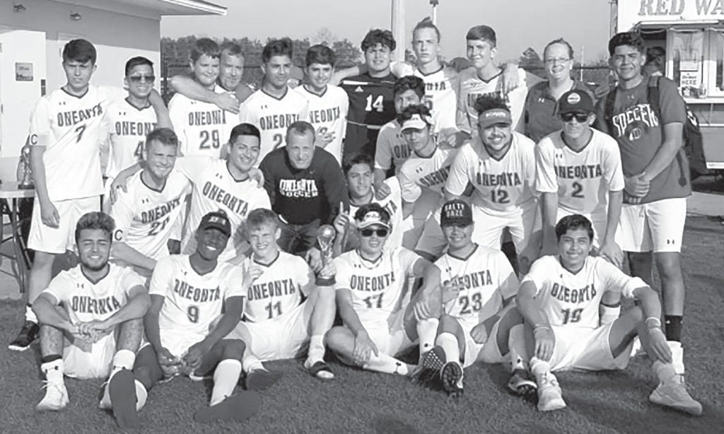 Oneonta's soccer team celebrates their championship in the Southern Shootout tournament in Foley. -Robin Stover