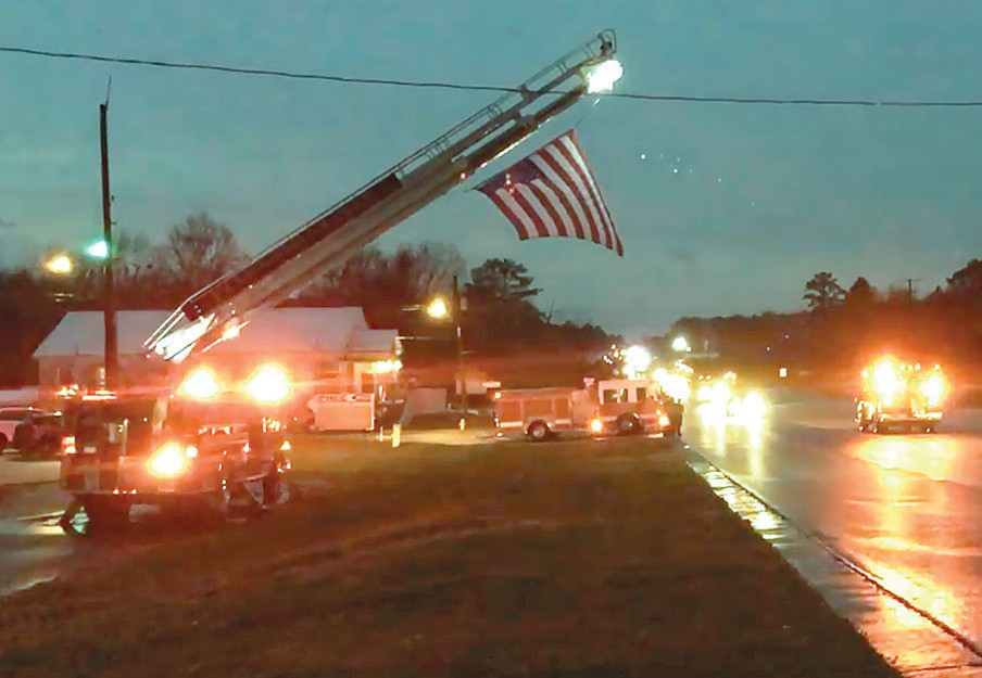 Palmerdale firefighter Brenden Pierce was honored by local firefigthers as he was brought from UAB Hospital through Palmerdale to Lemley Chapel in Oneonta. -Jonathan Ledbetter