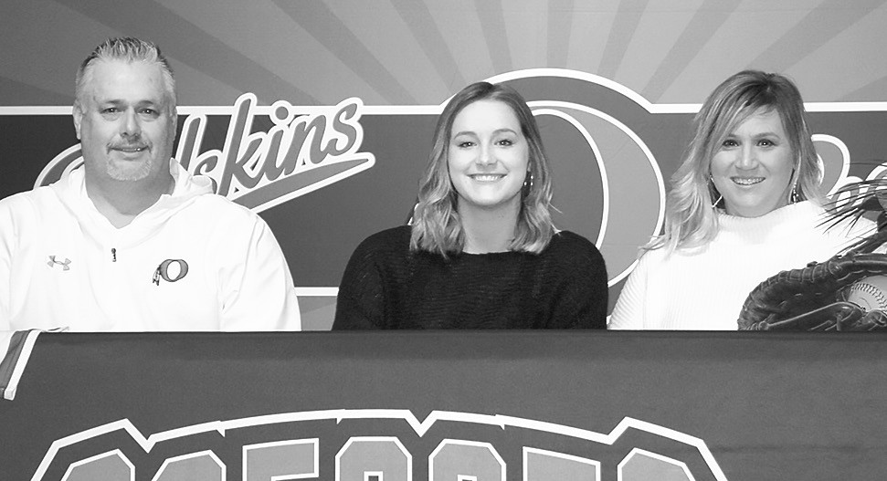 Allie Higginbotham (center) is pictured with parents Mark Higginbotham and Lenicia Roddam.