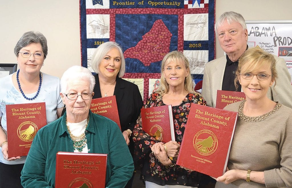 Museum board members (from left) Laura Roberson, Margaret Hudson, Deb Hicks, Cindy Self, Stanley Moss, and curator Amy Rhudy display the new Heritage of Blount County books.