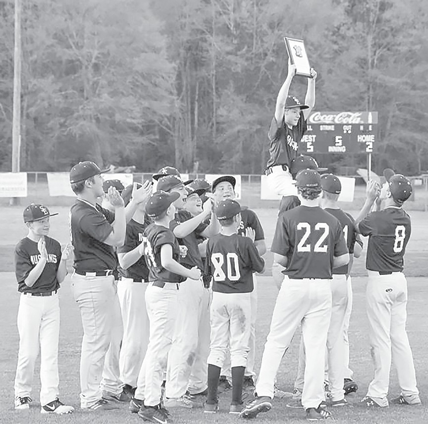 Southeastern junior high baseball players celebrate their victory in the Blount County tournament. -Jeff Sargent