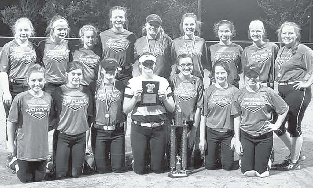 Hayden's junior high softball team celebrates their county tournament championship. -Hayden Softball | Facebook
