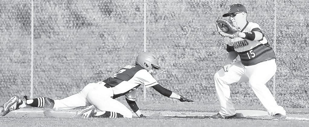 Cleveland's Bryson Browning dives to avoid the tag from Southeastern's Bryant Hathorn. -Jeff Sargent