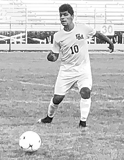 Fernando Aragon looks to pass during the Saks game. -Susan Moore Soccer
