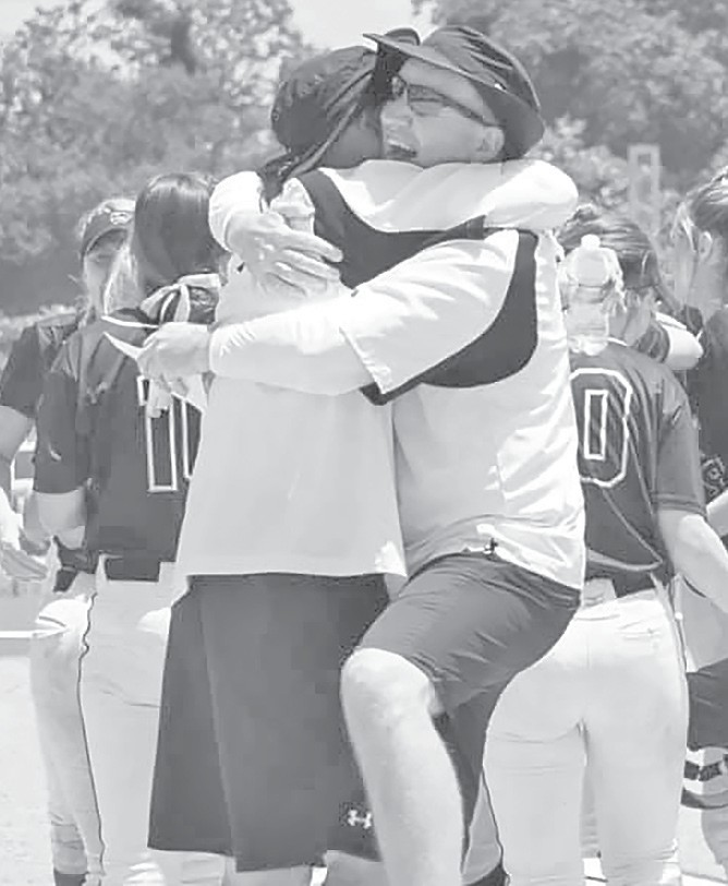 Coaches John Simmons and Kim Hargett hug it out after leading the Lady Wildcats to a state championship. -Jennifer Kirk