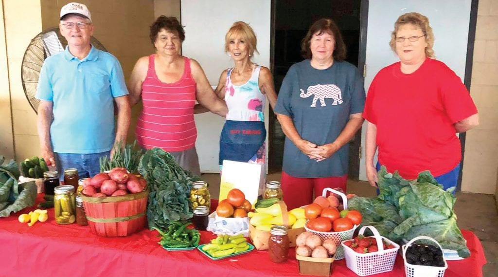 From left: Tony Hyatt, Debbie Frost, Virginia Witt, Martha Roberts, Janet Dooley, and others are ready to help at the Blount County Farmer's Market. -Johnny Roberts